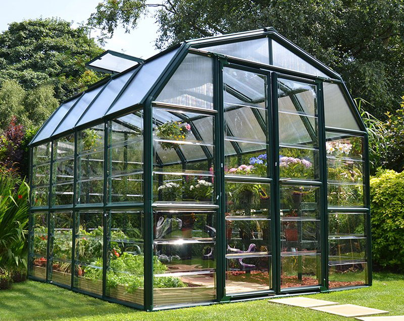 Green barn style greenhouse with a high eaves height